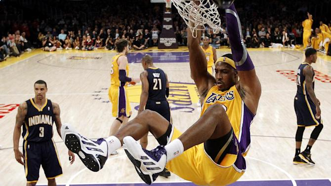 Los Angeles Lakers' Dwight Howard dunks against the Indiana Pacers in the first half of an NBA basketball game in Los Angeles, Tuesday, Nov. 27, 2012. (AP Photo/Jae C. Hong)