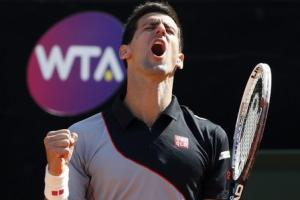 Djokovic reacts during his men's singles semi-final match against Raonic at the Rome Masters tennis tournament