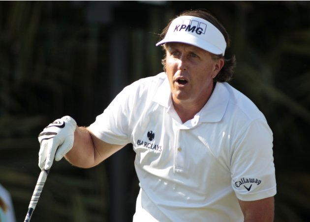 Phil Mickelson of the U.S. reacts after his tee shot on the eighth hole during second round play in the 2013 WGC-Cadillac Championship PGA golf tournament in Doral