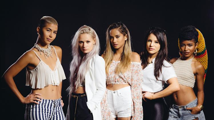 In this Tuesday, July 22, 2014 photo, from left, Paula Van Oppen, Lauren Bennett, Emmalyn Estrada, Natasha Slayton, and Simone Battle of the band, G.R.L. pose for a photo at The Beverly Hilton in Beverly Hills, Calif. Their self-titled new album released on July 29, 2014. (Photo by Casey Curry/Invision/AP)