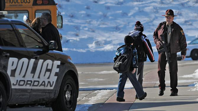 "A Minnesota State Patrol officer escorts students into New Prague Middle School in New Prague, Minn., Wednesday, March 20, 2013 after  authorities in New Prague responded to a 911 call concerning an ""active shooter"" at the middle school, but a staff member later said everyone is safe and there is no danger inside the building. The 911 call in which a caller claimed several people had been gunned down at the school was likely a hoax, Scott County Sheriff Kevin Studnicka said  said Wednesday. (AP Photo/The Star Tribune, Richard Sennott)  MANDATORY CREDIT; ST. PAUL PIONEER PRESS OUT; MAGS OUT; TWIN CITIES TV OUT"