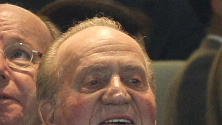 King Juan Carlos of Spain sits in the stands prior to the Champions League semifinal second leg soccer match between Real Madrid and Borussia Dortmund at the Santiago Bernabeu stadium in Madrid, Spain, Tuesday April 30, 2013. (AP Photo/Alberto Di Lolli)