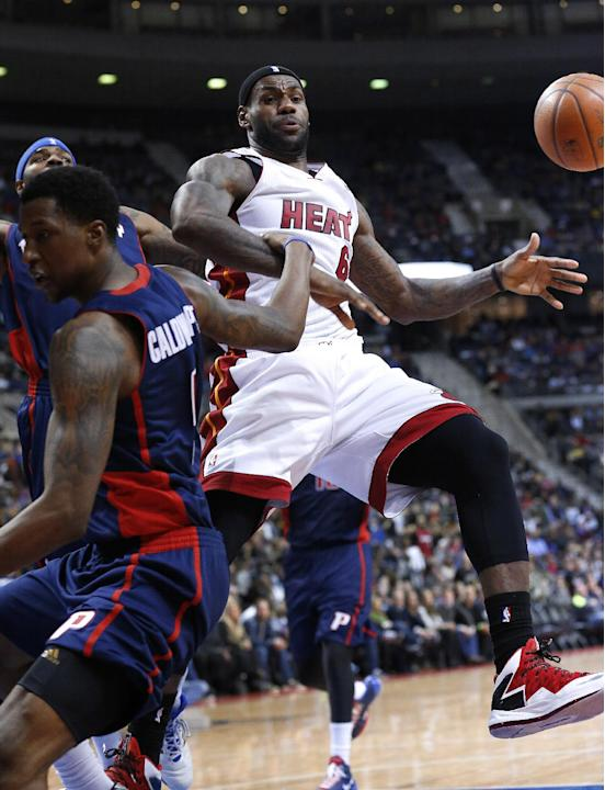 Miami Heat small forward LeBron James (6) is fouled by Detroit Pistons shooting guard Kentavious Caldwell-Pope (5) in the third quarter of an NBA basketball game in Auburn Hills, Mich., Sunday, Dec. 8