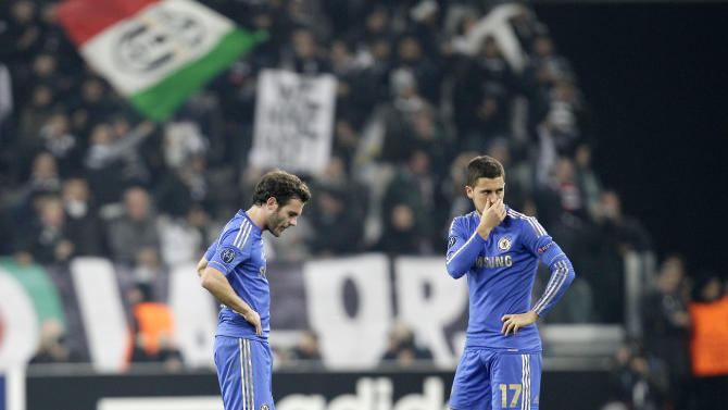 Chelsea's Eden Hazard, right, and Juan Mata look down after Juventus midfielder Arturo Vidal scored during a Champions League, Group E, soccer match between Juventus and Chelsea at the Juventus stadium in Turin, Italy, Tuesday, Nov. 20, 2012. (AP Photo/Antonio Calanni)