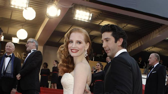 Actors Jessica Chastain, left and David Schwimmer arrive for the screening of Madagascar 3: Europe's Most Wanted at the 65th international film festival, in Cannes, southern France, Friday, May 18, 2012. (AP Photo/Lionel Cironneau)