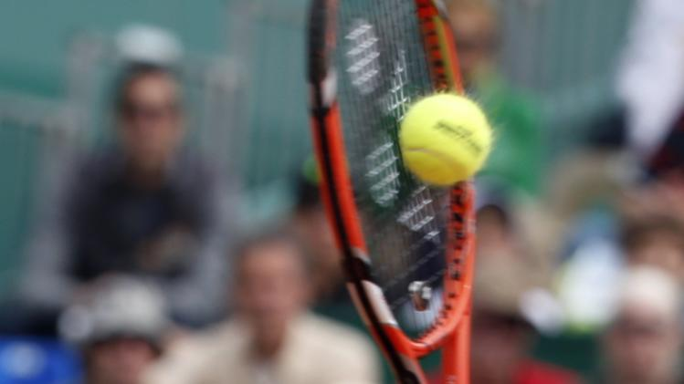Wawrinka of Switzerland returns the ball to Raonic of Canad during their quarter-final match at the Monte Carlo Masters in Monaco