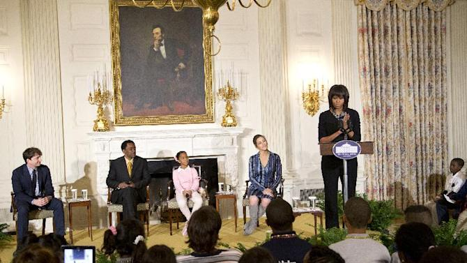 First lady Michelle Obama speaks in the State Dining Room of the White House in Washington, Wednesday, Feb. 13, 2013, during a celebration of the Black History Month, welcoming middle and high school students from the District of Columbia area and New Orleans taking part in an interactive student workshop with the cast and crew of the film Beasts of the Southern. From left are, Benh Zeitlin, Dwight Henry, Quvenzhané Wallis and Rachel Goslins.    (AP Photo/Manuel Balce Ceneta)