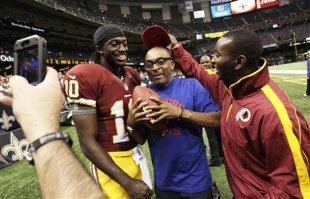 Robert Griffin III (L) poses for a photo with filmmaker Spike Lee (C) after his successful debut. (AP)