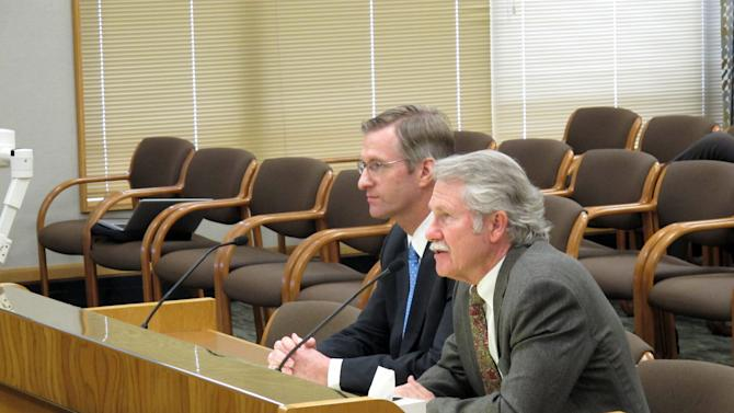 Oregon Gov. John Kitzhaber, right, tells lawmakers on the Senate Finance and Revenue Committee that he supports changing the state's kicker law to increase savings as State Treasurer Ted Wheeler listens at the state Capitol in Salem, Ore., on Wednesday, April 6, 2011. Corporations and individuals in Oregon get kicker checks when the state collects more in taxes than anticipated. Some lawmakers from both parties say the checks promote volatility in state budgets and make it difficult for the state to save money. The Senate Finance and Revenue Committee will hear testimony from the governor and others on a bill that would scale back kicker payments and instead save the money for higher education.  (AP Photo/Jonathan J. Cooper)