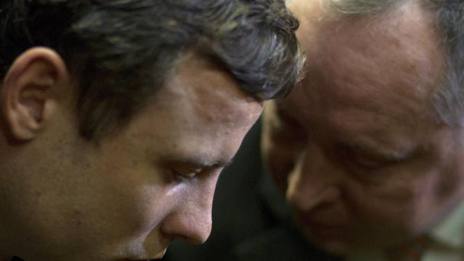 FILE : In this Monday, Aug. 19, 2013 file photo, double-amputee Olympian Oscar Pistorius, left, talks with his lawyer, Kenny Oldwage, right, at the magistrates court in Pretoria, South Africa, where Pistorius was indicted on charges of murder and illegal possession of ammunition for the shooting death of his girlfriend on Valentine's Day. Ahead of Pistorius' trial, starting Monday, March 3, 2014, legal experts say Pistorius would still be vulnerable to a homicide conviction even if he is acquitted of murdering Steenkamp. (AP Photo/Themba Hadebe-File)