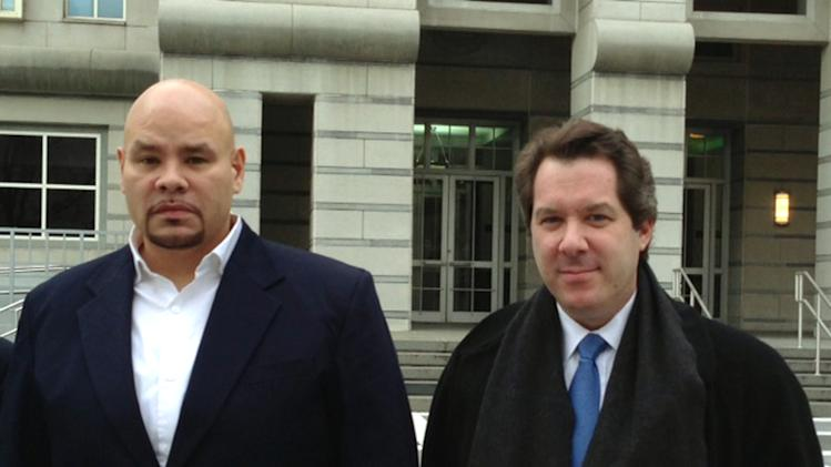 """Fat Joe,"" left, whose real name is Joseph Cartagena, leaves court with his attorney Jeffrey Lichtman in Newark N.J., Thursday, Dec. 20, 2012. The rap star faces up to two years in prison after pleading guilty in federal court to failing to pay taxes on nearly $3 million in income over two years. (AP Photo/Samantha Henry)"