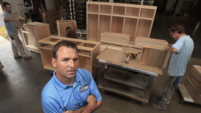 "In this Wednesday, Sept. 5, 2012 photo, Aaron Foust, who owns a wood refinishing company, poses for a photo in his workshop in Streetsboro, Ohio. Foust, a former Gov. Mitt Romney supporter, says President Barack Obama's words about welfare recipients don't match his deeds. Publicly, Foust says, the president is urging ""them to go to work, but if they (did) ... they wouldn't need him anymore. He needs their vote. As long as they're dependent on the government, they're going to vote for the people that give them money."" (AP Photo/Tony Dejak)"