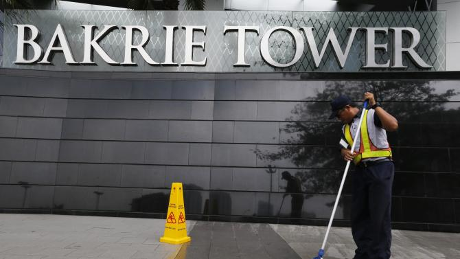 A worker cleans the floor at Bakrie Tower in Jakarta
