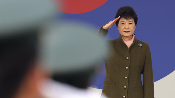 South Korean President Park Geun-hye salutes during the joint commission ceremony of 5,780 new officers of Army, Navy, Air Force and Marines at the Gyeryong military headquarters in Gyeryong, south of Seoul, South Korea, Friday, March 8, 2013. North Korea has escalated its bellicose statements this week as the tightening of U.N. sanctions loomed. It has also threatened to scrap the cease-fire that ended the 1950-53 Korean War. (AP Photo/Yonhap, Ahn Jung-won) KOREA OUT