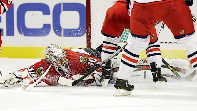 Chicago Blackhawks goalie Ray Emery blocks a shot by Columbus Blue Jackets' Cam Atkinson (13) during the first period of an NHL hockey game in Chicago, Friday, March 1, 2013. (AP Photo/Nam Y. Huh)