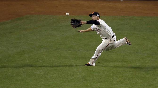 San Francisco Giants' Juan Perez catches a ball hit by Kansas City Royals' Alex Gordon during the seventh inning of Game 4 of baseball's World Series Saturday, Oct. 25, 2014, in San Francisco. (AP Photo/Eric Risberg)