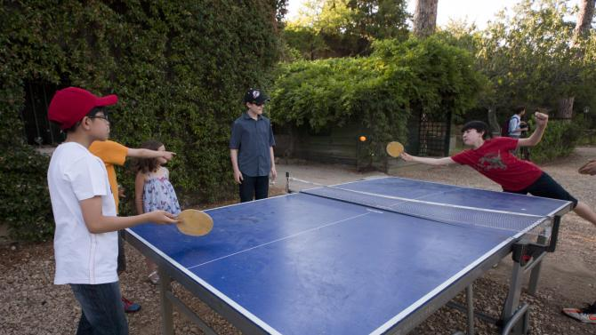 Young members of the Westminster choir play table tennis at the American Academy soon after arriving in Rome, Tuesday, June 26, 2012. The Westminster Abbey Choir, the world-renown chorus which last year performed at the wedding of Prince William and Kate Middleton, will join the Sistine singers at a special papal Mass on Friday in St. Peter's Basilica, a historic event seen as a perfect symbol of Christian harmony _ after centuries of discord. It's the first time in its 500-plus year history that the pope's personal choir will be accompanied by another chorus, let alone one that comes from the breakaway Anglican Church. (AP Photo/Domenico Stinellis)