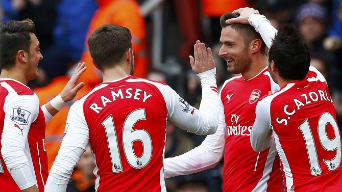 Arsenal's Giroud celebrates his goal against Aston Villa with team mates during their English Premier League soccer match in London