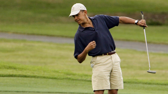 FILE - In this Dec. 31, 2009 file photo, President Barack Obama watches the ball after making a putt on the ninth green during his golf match at Mid-Pacific County Club in Kailua, Hawaii. Obama played golf Sunday, Feb. 17, 2013 with Tiger Woods, the White House said Sunday. Once the sport's dominant player before his career was sidetracked by scandal, Woods joined Obama at the Floridian, a secluded and exclusive yacht and golf club on Florida's Treasure Coast where Obama is spending the long Presidents Day weekend. The two had met before, but Sunday was the first time they played together. (AP Photo/Chris Carlson, File)