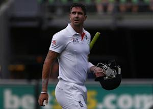 England's Pietersen walks off the field after his dismissal by Australia's Johnson during the second day of the fourth Ashes cricket test at the Melbourne cricket ground