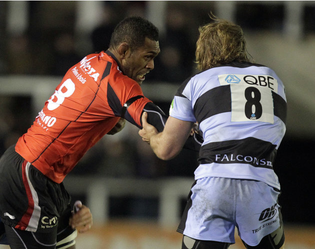 Newcastle Falcons' Richard Mayhew (R) tackles Toulon's Seva Rokobaro (L) during a pool 2, European Challenge Cup rugby union match at Kingston Park, Newcastle upon Tyne, England, on December 08, 2011.