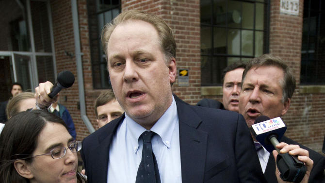 FILE - In this May 16, 2012, former Boston Red Sox pitcher Curt Schilling, center, is followed by members of the media as he departs the Rhode Island Economic Development Corporation headquarters in Providence, R.I. The state of Rhode Island's economic development agency has filed a lawsuit against Schilling on Thursday, Nov. 12, 2012, and some of its own former officials in connection with a $75 million loan guarantee to his failed video game company. (AP Photo/Steven Senne, File)