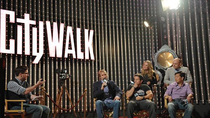 "IMAGE DISTRIBUTED FOR MTV- Members from the cast and crew of of  ""Pain & Gain"" director Michael Bay actors Mark Wahlberg Ken Jeong,  Rob Corddry, and Bar Pal, are seen on stage with MTV News' Josh Horowitz, left, during ""The MTV Movie Awards Sneak Peek Week"" on Tuesday, April 9, 2013 in Universal City, Calif. (Photo by John Shearer/Invision for MTV/AP Images)"