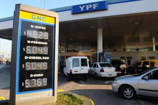 <p>Cars line up at an YPF gas station in Buenos Aires. Recently nationalized Argentine oil firm YPF announced it has signed an agreement with US energy giant Chevron to explore and develop shale oil and gas in the Vaca Muerta reserves of southern Argentina.</p>