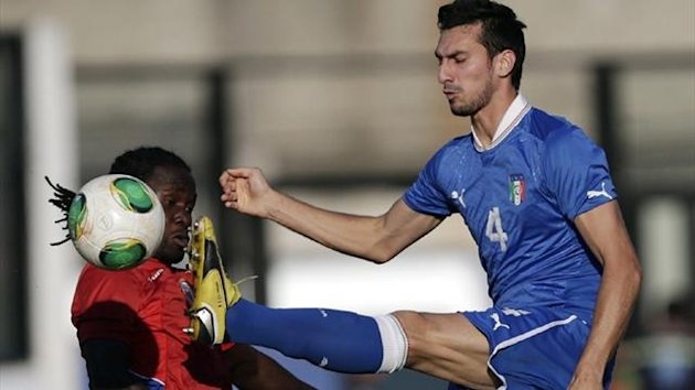 Italy's Davide Astori fights for the ball with Haiti's Kevin Fils Belfort (Reuters)