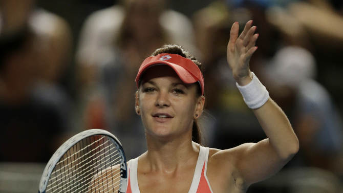 Poland's Agnieszka Radwanska waves to the crowd following her third round win over Britain's Heather Watson at the Australian Open tennis championship in Melbourne, Australia, Friday, Jan. 18, 2013. (AP Photo/Rob Griffith)