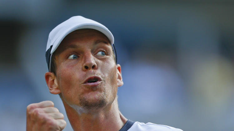 Tomas Berdych, of the Czech Republic, reacts after a point against Martin Klizan, of Slovakia, during the second round of the 2014 U.S. Open tennis tournament, Friday, Aug. 29, 2014, in New York. (AP Photo/Matt Rourke)