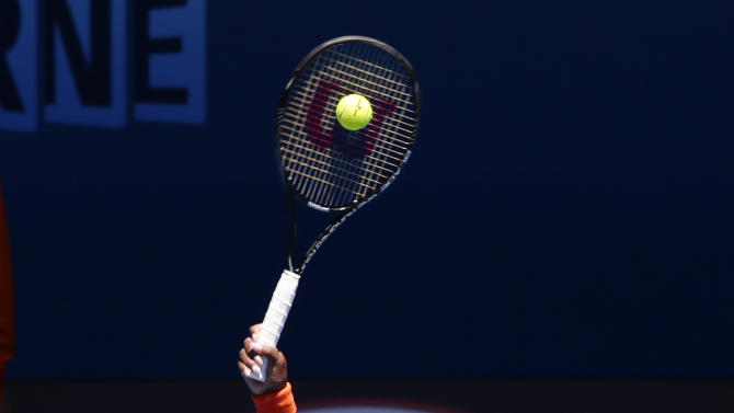 Serena Williams of the US serves to Japan's Ayumi Morita during their third round match at the Australian Open tennis championship in Melbourne, Australia, Saturday, Jan. 19, 2013. (AP Photo/Andy Wong)