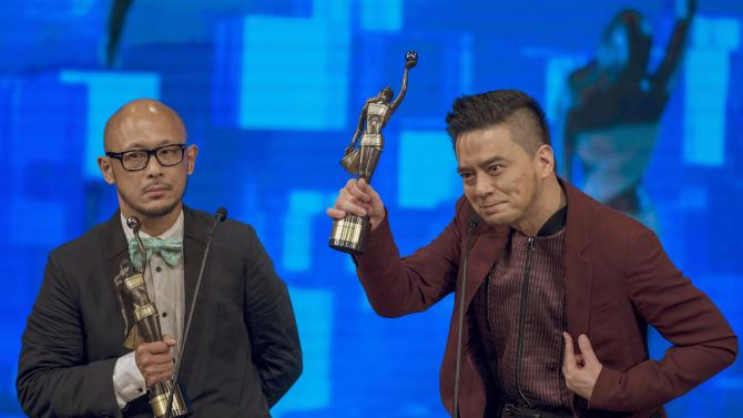 "Hong Kong singer Anthony Wong Yiu-Ming reacts with composer Jason Choi on winning the Best Original Film Song for ""Aberdeen"" during the Hong Kong Film Awards"