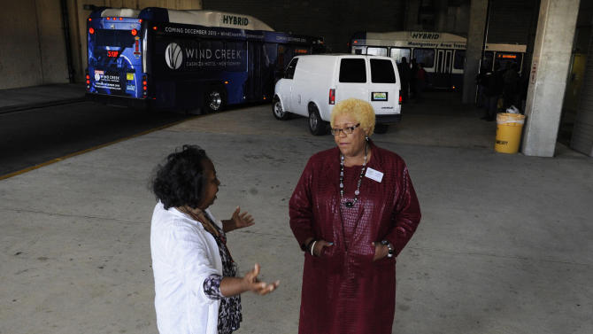 This photo taken Monday, Nov. 17, 2015, shows Montgomery Transportation Coalition members Alma Sankey, left, and Callie Greer discussing the 60th anniversary of a historic bus boycott in Montgomery, Ala. Six decades after Rosa Parks was arrested for refusing to give up her bus seat to a white man, the city's buses have a mostly black ridership and are the target of frequent complaints about poor service. (AP Photo/Jay Reeves)