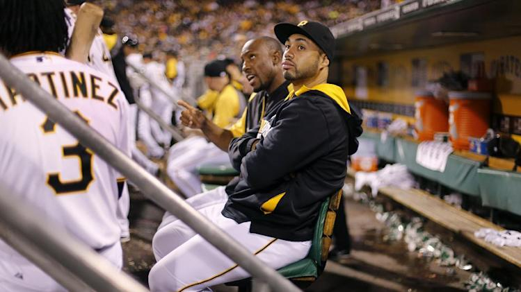 Pittsburgh Pirates third baseman Pedro Alvarez, center, sits in the dugout with teammate Starling Marte, rear center, during a baseball game in Pittsburgh Wednesday, July 23, 2014. The Pirates won 6-1, and neither Alvarez or Marte played. (AP Photo)