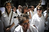 <p>Hundreds of doctors in white smocks took to the streets of the Portuguese capital Wednesday, the first day of a two-day nationwide strike over sweeping austerity cuts to the health budget.</p>