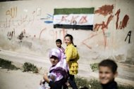 <p>Syrian students walk home after attending classes at an improvised school in the town of Azaz, on the border with Turkey. Over 2,000 Syrian schools have been damaged or destroyed and hundreds more are being used as shelters, the UN says.</p>
