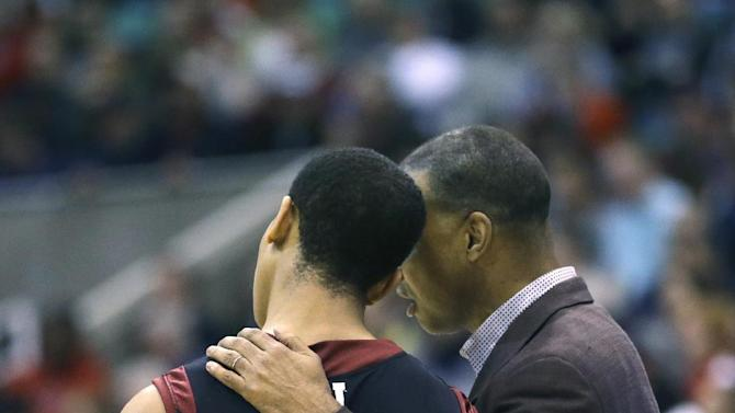 Harvard head coach Tommy Amaker talks with Harvard's Siyani Chambers (1) in the second half during a second-round game against New Mexico in the NCAA college basketball tournament in Salt Lake City Thursday, March 21, 2013. Harvard defeated New Mexico 68-62. (AP Photo/Rick Bowmer)