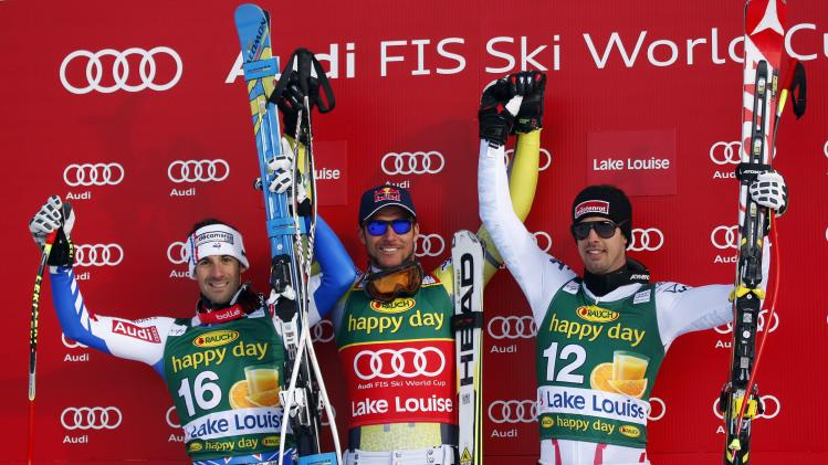 Norway's Aksel Lund Svindal, center, celebrates his win with second place finisher Adrien Theaux, left, of France, and third place finisher Joachim Puchner, of Austria, at the men's World Cup super-G ski race event in Lake Louise, Alberta, Sunday Nov. 25, 2012. (AP Photo/The Canadian Press, Jeff McIntosh)