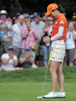 RECROPPED VERSION - So Yeon Ryu, of South Korea, pauses on the 18th green after winning the 2011 Women's U.S. Open golf tournament at the Broadmoor Golf Club on Monday, July 11, 2011, in Colorado Springs, Colo. (AP Photo/Mark J. Terrill)
