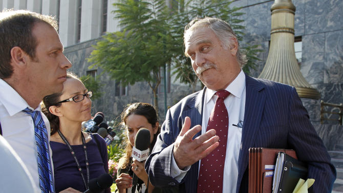 "Steve Seiden, attorney for Mark Basseley Youssef, speaks after a hearing for his client at U.S. District Court in Los Angeles Wednesday, Nov. 7, 2012. Youssef was sentenced to a year in prison for violating his probation stemming from a 2010 bank fraud conviction by lying about his identity.  He admitted to four of the eight alleged violations, including obtaining a fraudulent California driver's license.  None of the violations had to do with the content of ""Innocence of Muslims,"" a film that depicts Mohammad as a religious fraud, pedophile and a womanizer. The movie sparked violence in Libya and other parts of the Middle East, killing dozens. (AP Photo/Reed Saxon)"