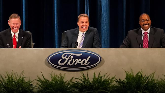 Executive Chairman for Ford Motor Company William Ford, center, Ford President and CEO Alan Mulally, left, and Bradley Gayton share a laugh during the company's annual shareholders meeting at the Hotel DuPont in Wilmington, Del., Thursday, May 10, 2012. Thursday's meeting lasted only 45 minutes, much of it spent with shareholders praising CEO Alan Mulally and Executive Chairman Bill Ford Jr. for the company's turnaround.  (AP Photo/Ron Soliman)