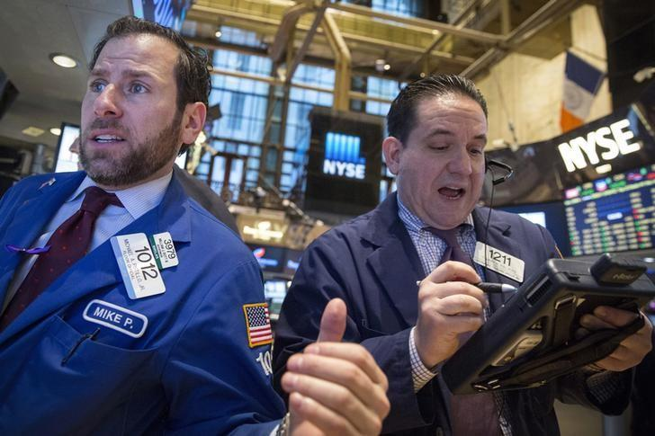 Wall St retreats but indexes set for quarterly gain