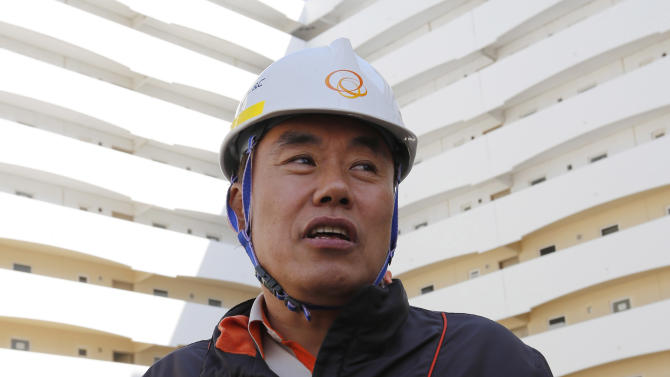 Project Director Salim Kim speaks to Reuters at Bismayah residential project in Baghdad
