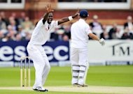 West Indies' captain Darren Sammy (L) appeals unsuccessfully for the wicket of England's Jonathan Trott (R) during the second day of the first Test at Lord's cricket ground in London