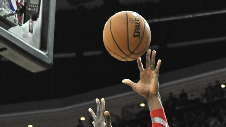 Houston Rockets' Dwight Howard (12) shoots for two points against Indiana Pacers' Roy Hibbert (55) in the first half of an NBA basketball game on Friday, March 7, 2014, in Houston. (AP Photo/Pat Sullivan)