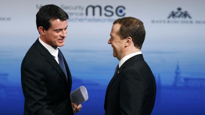 French Prime Minister Valls shakes hands with Russian Prime Minister Medvedev at the Munich Security Conference in Munich