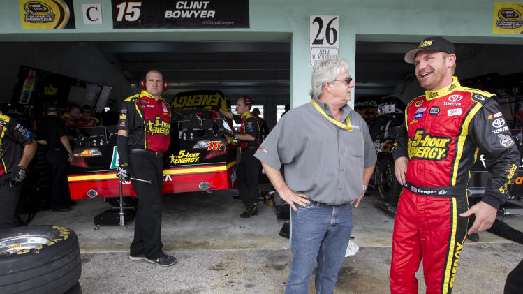 Driver Clint Bowyer, right, talks to a official during the practice for Sunday's NASCAR Sprint Cup Series auto race, Sunday, at the Homestead-Miami Speedway in Homestead, Fla., Friday, Nov. 16, 2012. (AP Photo/J Pat Carter)