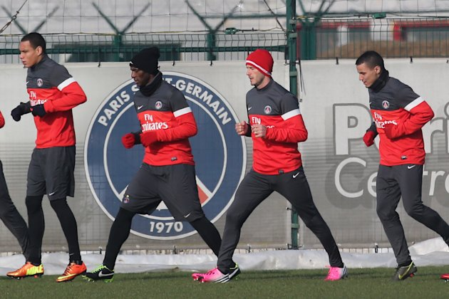 David Beckham is seen with his teammates during a practice session with Paris Saint-Germain soccer team in Saint-Germain-en-Laye, west of Paris, Wednesday, Feb. 13, 2013. David Beckham started his fir