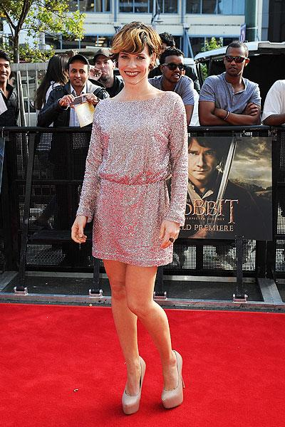 "Look who we found: Evangeline Lilly! The former 'Lost' actress wears a daring new short haircut with blond streaks in her bangs. Lilly, who used to date ""Lord of the Rings"" and ""Lost"" actor Dominic Monaghan, wears a shimmering mini dress à la Old Hollywood and sky-high nude pumps. (Photo by Mark Tantrum/WireImage)"